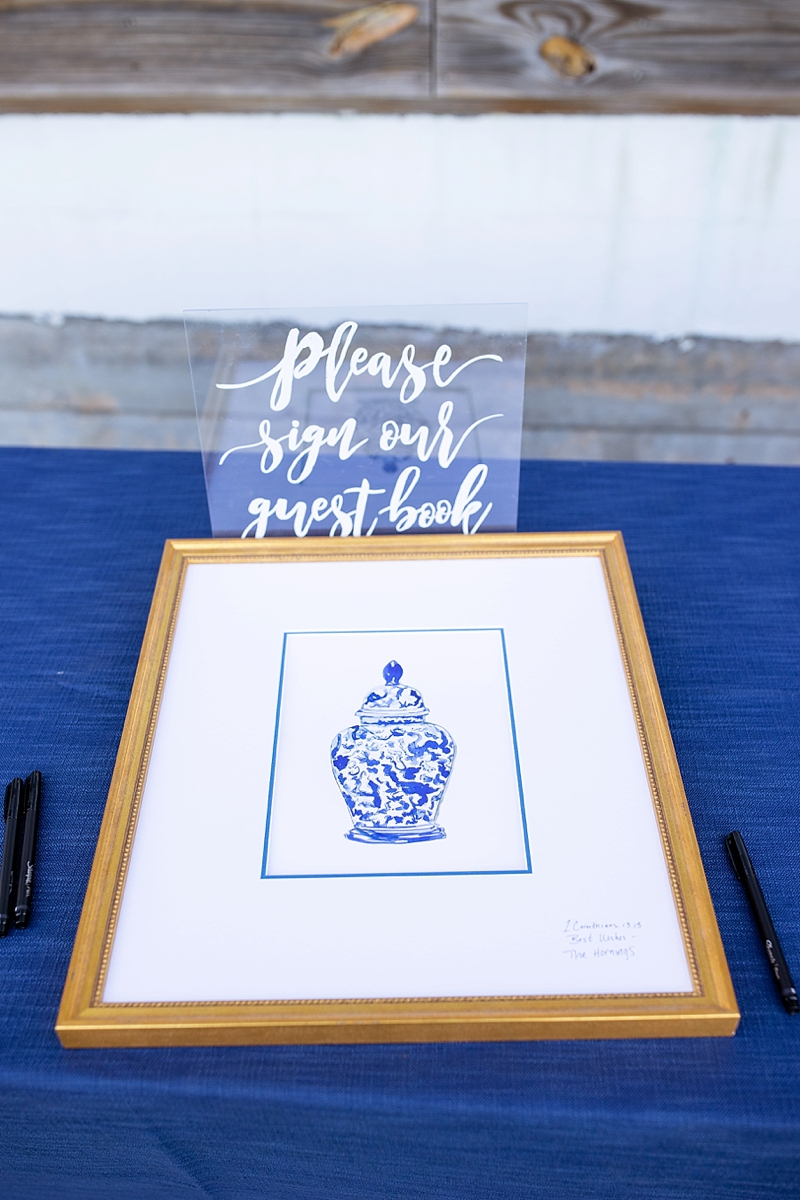 Beautiful framed blue and white ginger jar illustration print for wedding guestbook that guests sign