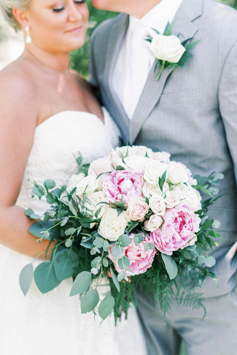 Pink and white bridal bouquet filled with peonies and roses and ferns for classic Outer Banks wedding during COVID19