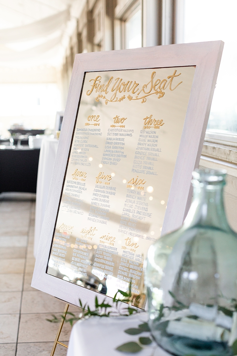 Classic mirror wedding seating chart with gold and white calligraphy for beach wedding at Sanderling Resort in the Outer Banks