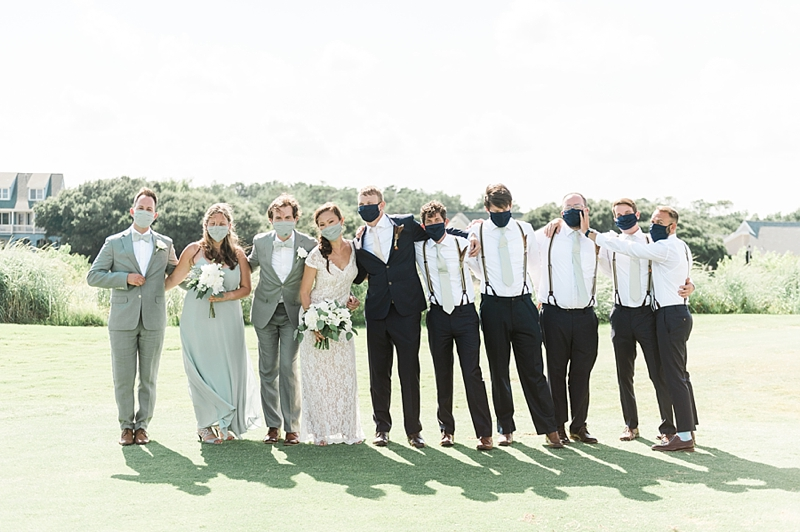 Intimate COVID affected wedding with bridesmaids and groomsmen in matching face masks at the Currituck Club in Outer Banks
