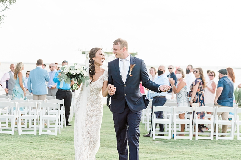 Romantic COVID affected wedding at the Currituck Club in Outer Banks with bride and groom celebrating their wedding vows