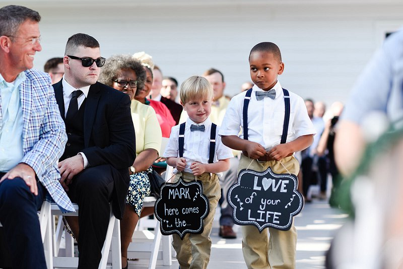 Adorable handmade ring bearer chalkboard signs for outdoor wedding ceremony