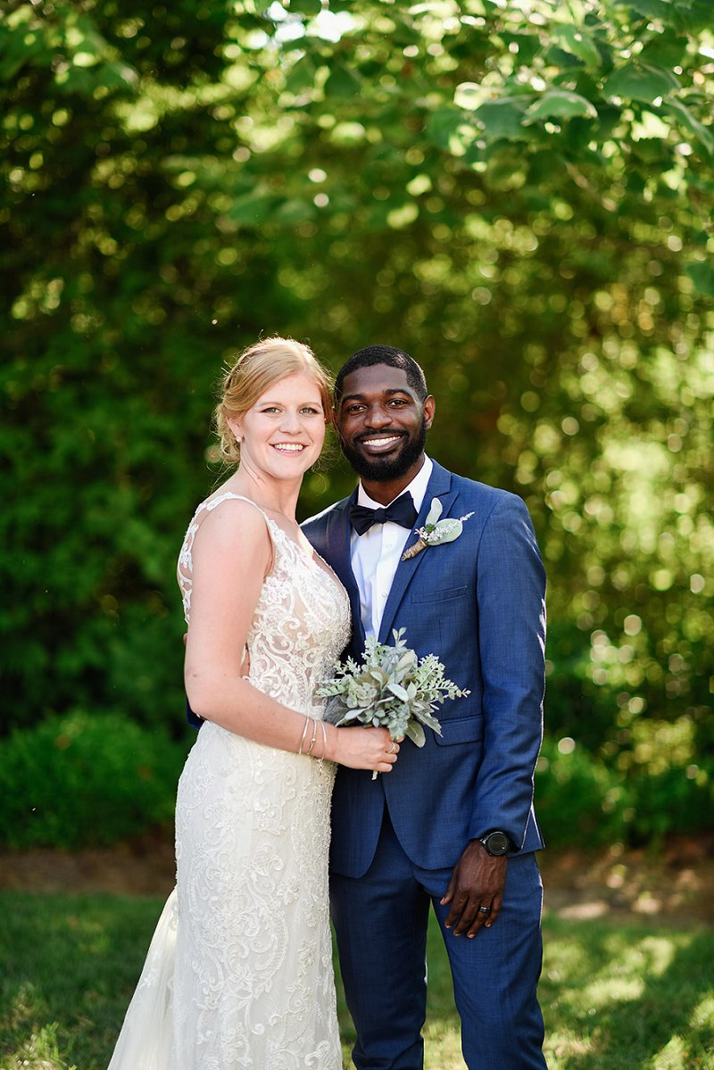 Simply chic spring wedding at the Womans Club of Portsmouth in Hampton Roads Virginia with bride and groom wearing classic wedding dress and suit