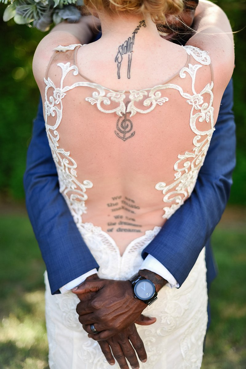 White wedding dress with statement keyhole lace illusion back to show off bridal tattoos