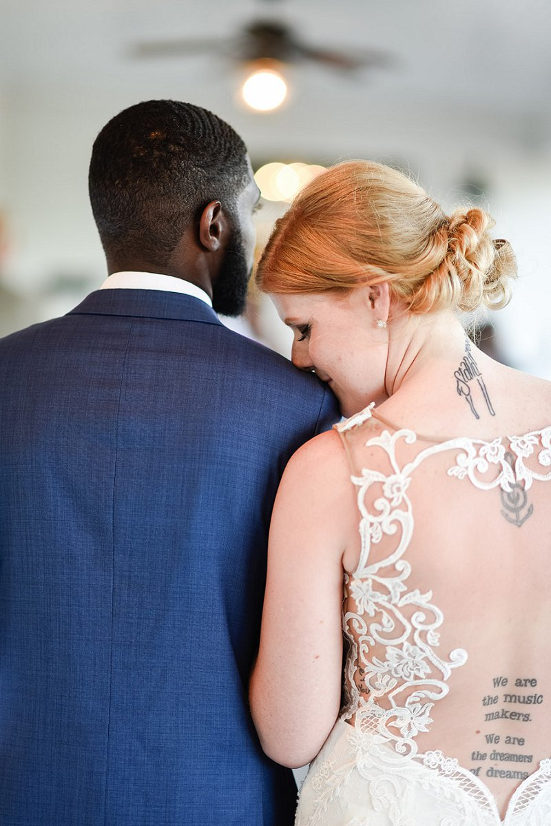 Sweet wedding day moment between bride and groom at the Womans Club of Portsmouth in Virginia
