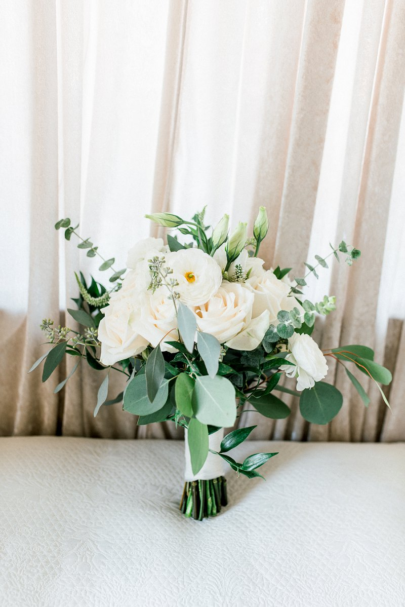 Small all white wedding bouquet with ranunculus and roses for classic wedding