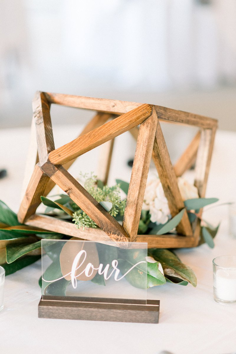 Wooden geometric wedding table centerpiece and clear acrylic table number for modern rustic wedding theme ideas