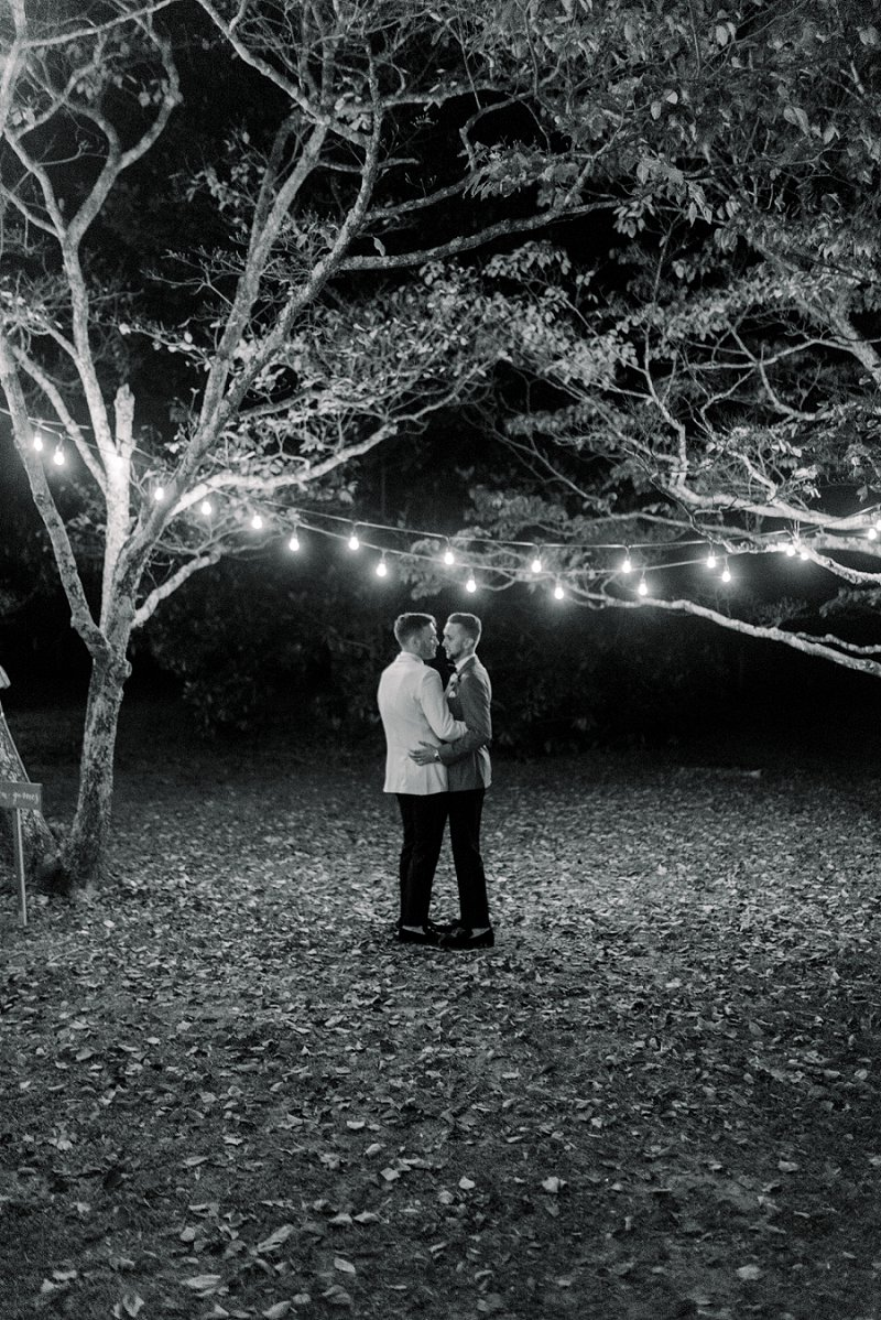 Two modern classic grooms sharing a last dance moment at Seven Springs in Richmond Virginia on Virginia Wedding Blog