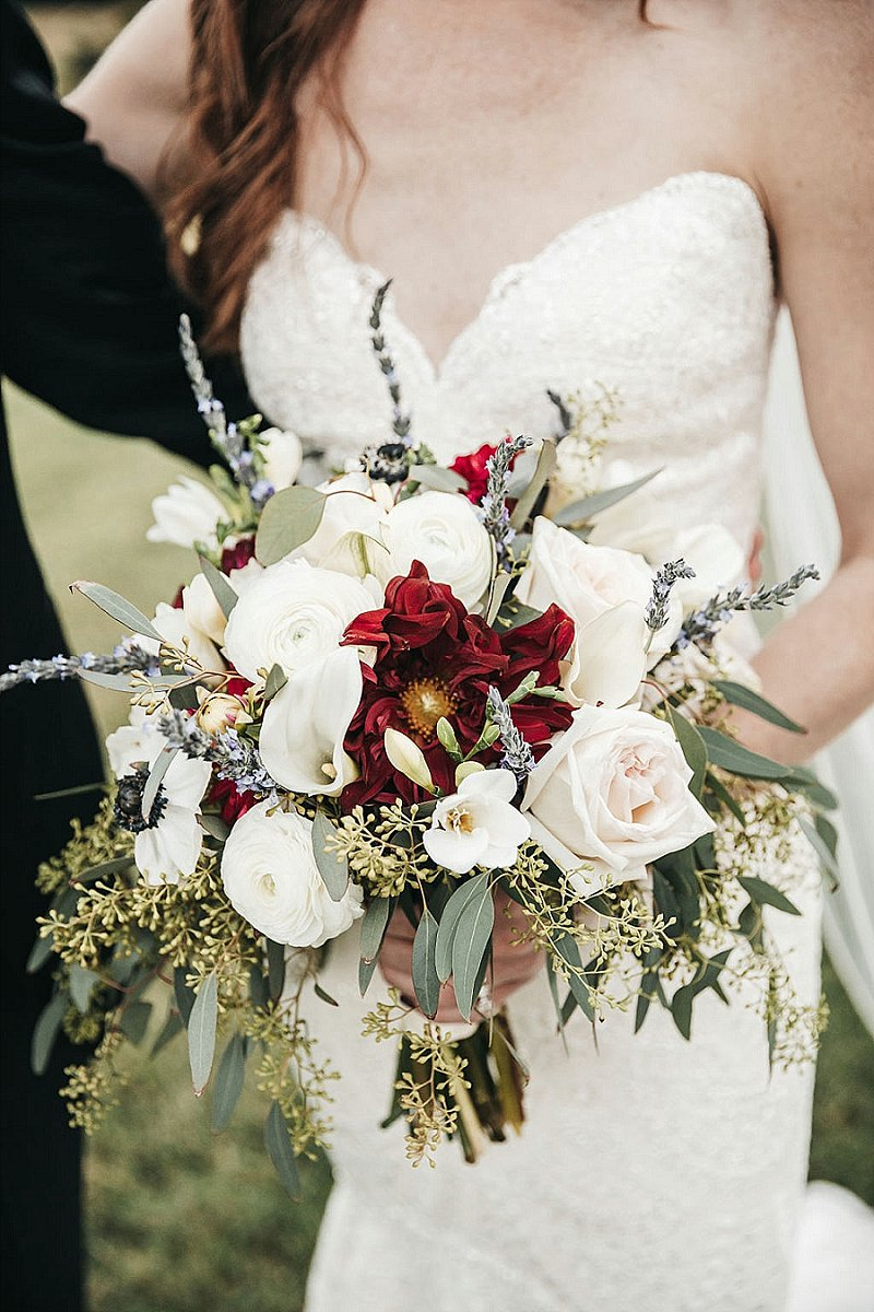 Gorgeous wedding bouquet with red flowers eucalyptus and ranunculus for classic bridal style