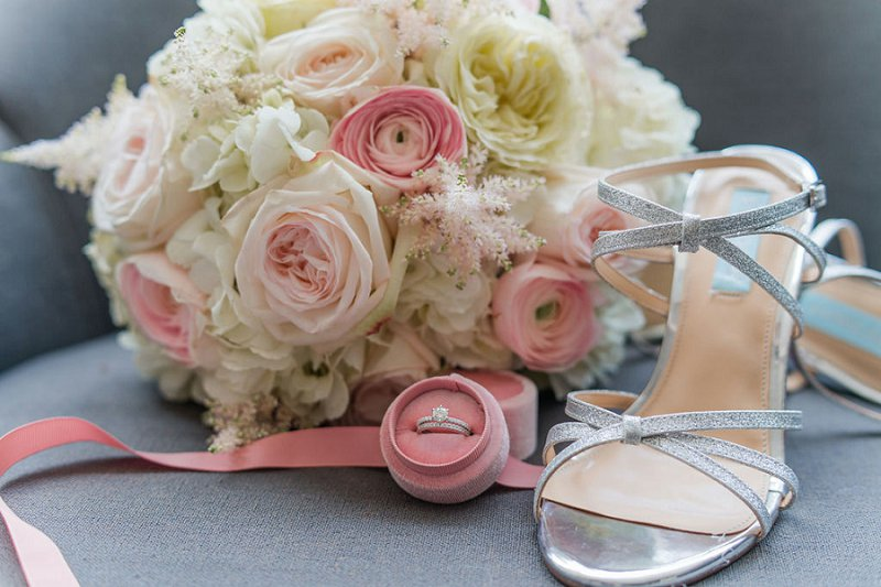 Silver strappy sandal bridal heels with classic pink and white wedding bouquet