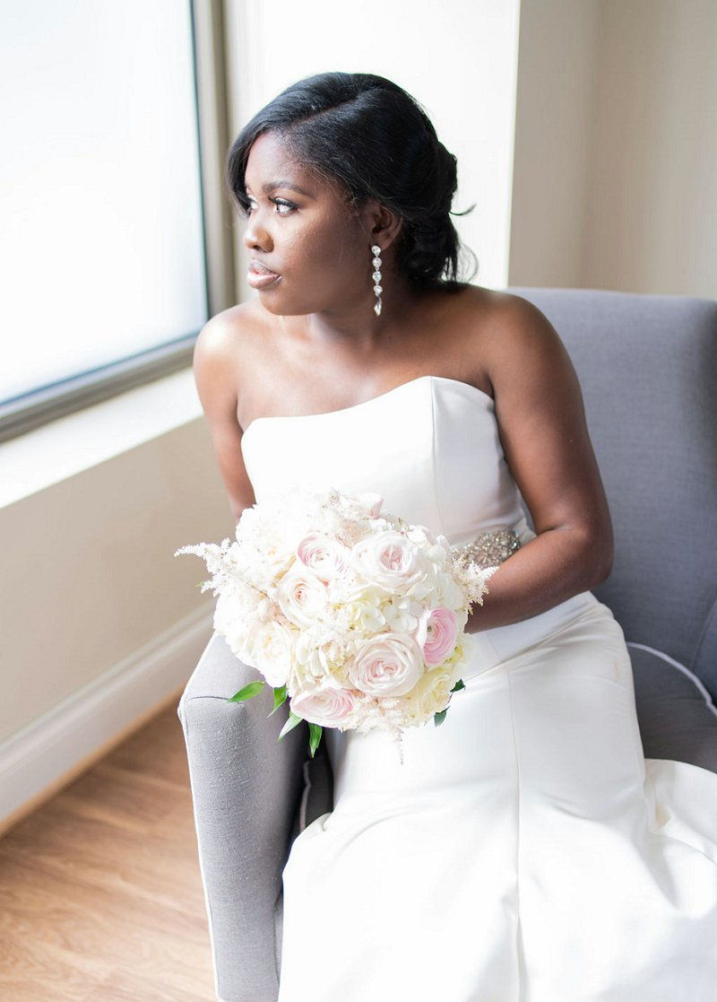 Gorgeous black bride with long chandelier earrings and chic updo for classic ballroom wedding in Richmond Virginia