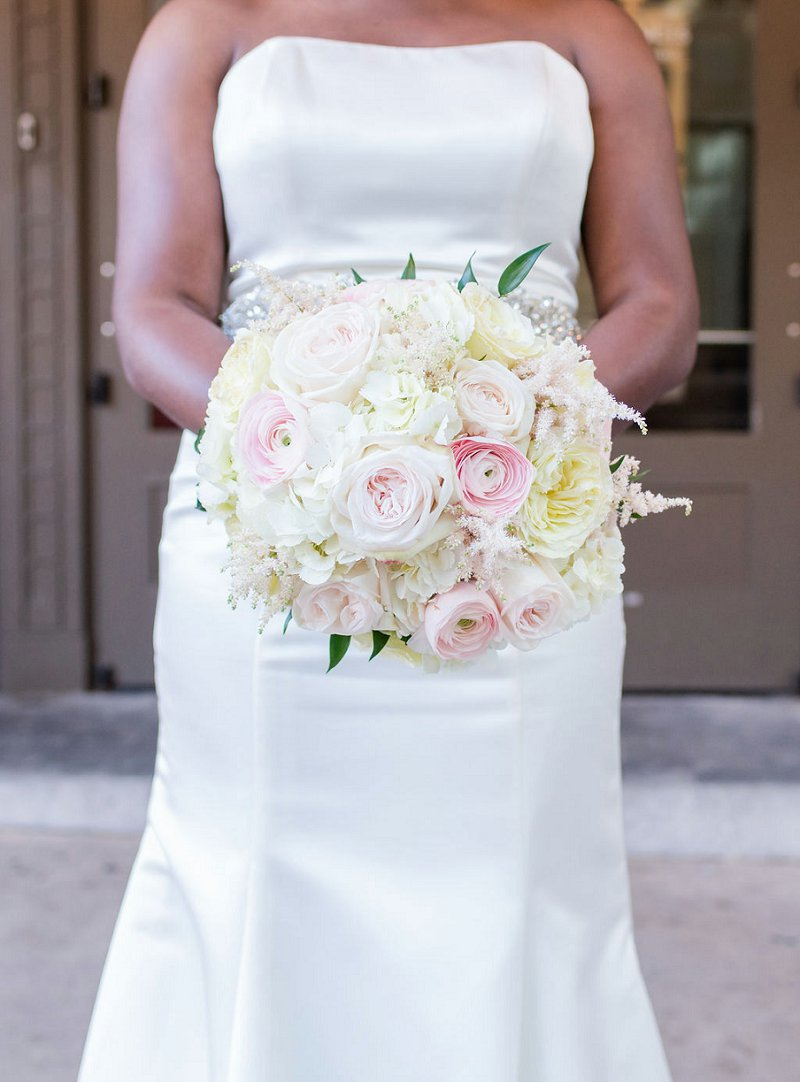 Classic white and pink wedding bouquet with roses and ranunculus