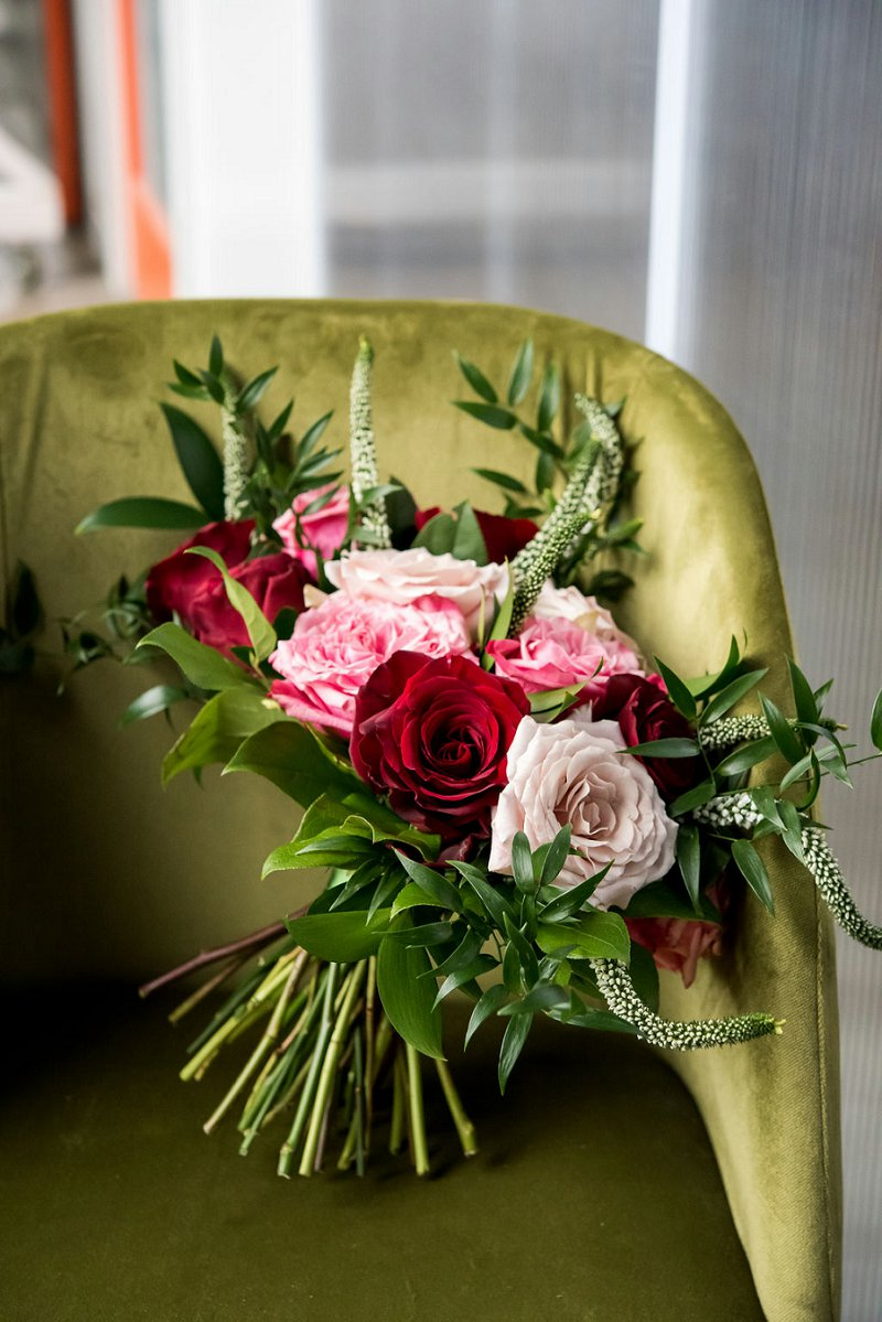 Modern small red and pink wedding bouquet with greenery and veronica flowers