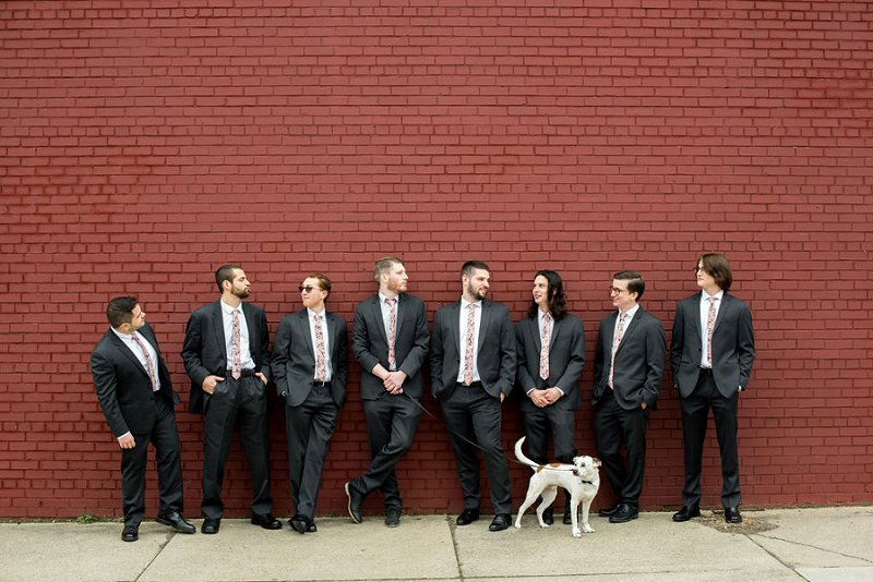 Modern wedding style with groomsmen wearing pink patterned floral neckties and black suits