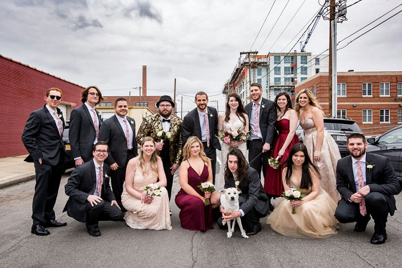 Modern urban wedding party with eclectic attire and a groomsmaid in a fabulous gold and black patterned suit
