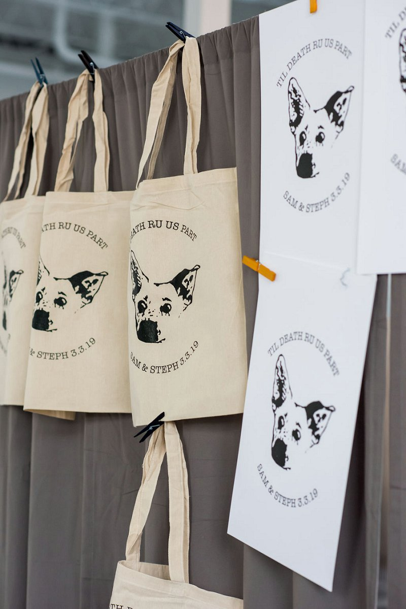 Fun handmade printmaking station with dog themed tote bags for unique wedding favors