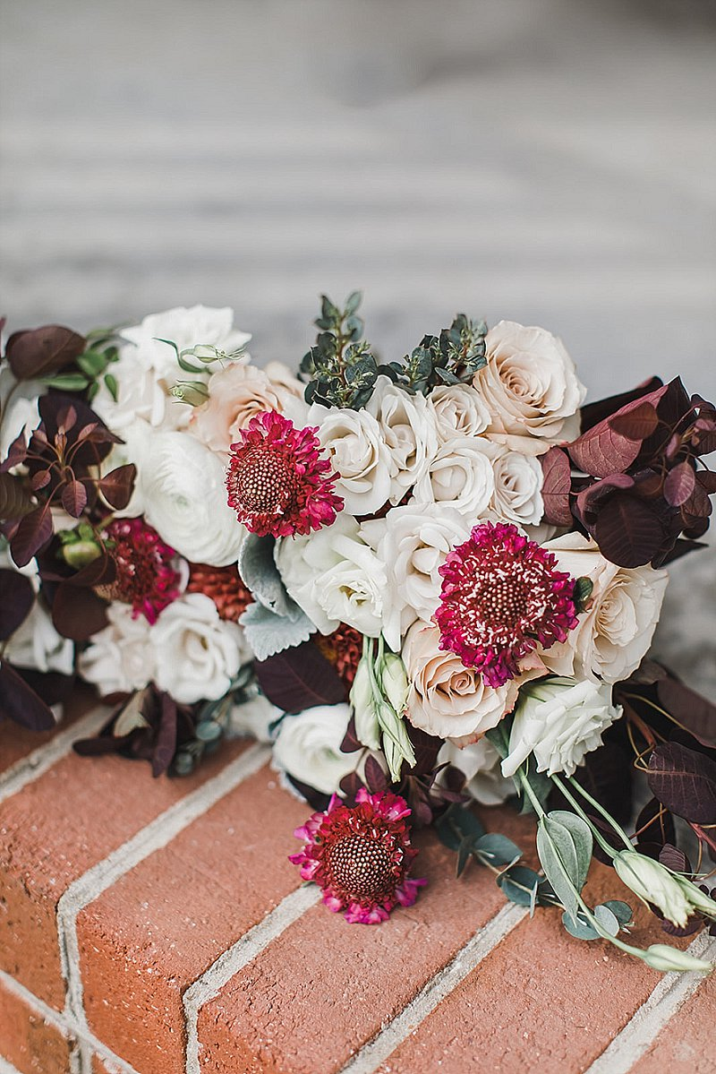 Gorgeous moody fall wedding bouquet with burgundy and white flowers