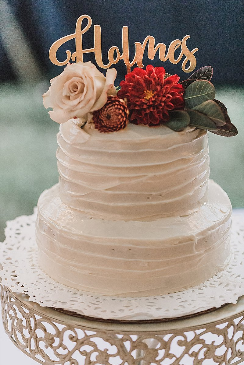 Yummy homemade funfetti wedding cake with floral topper
