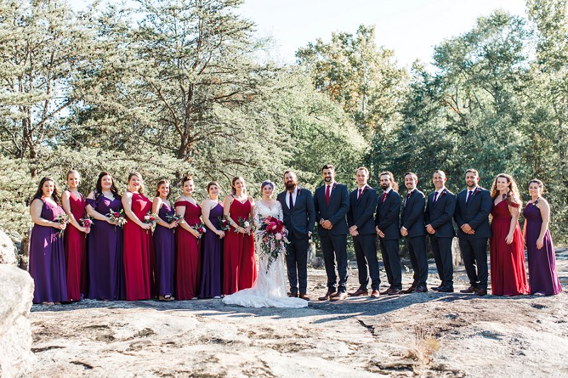 Wedding party in gray suits and gorgeous purple plum bridesmaid dresses for fall vintage wedding at Mill at Fine Creek in Powhatan Virginia