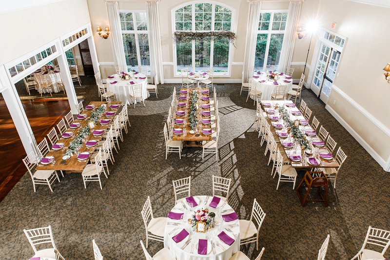 Vintage rustic style wedding reception tables with long wooden table and white chiavari chairs at Mill at Fine Creek near Richmond Virginia
