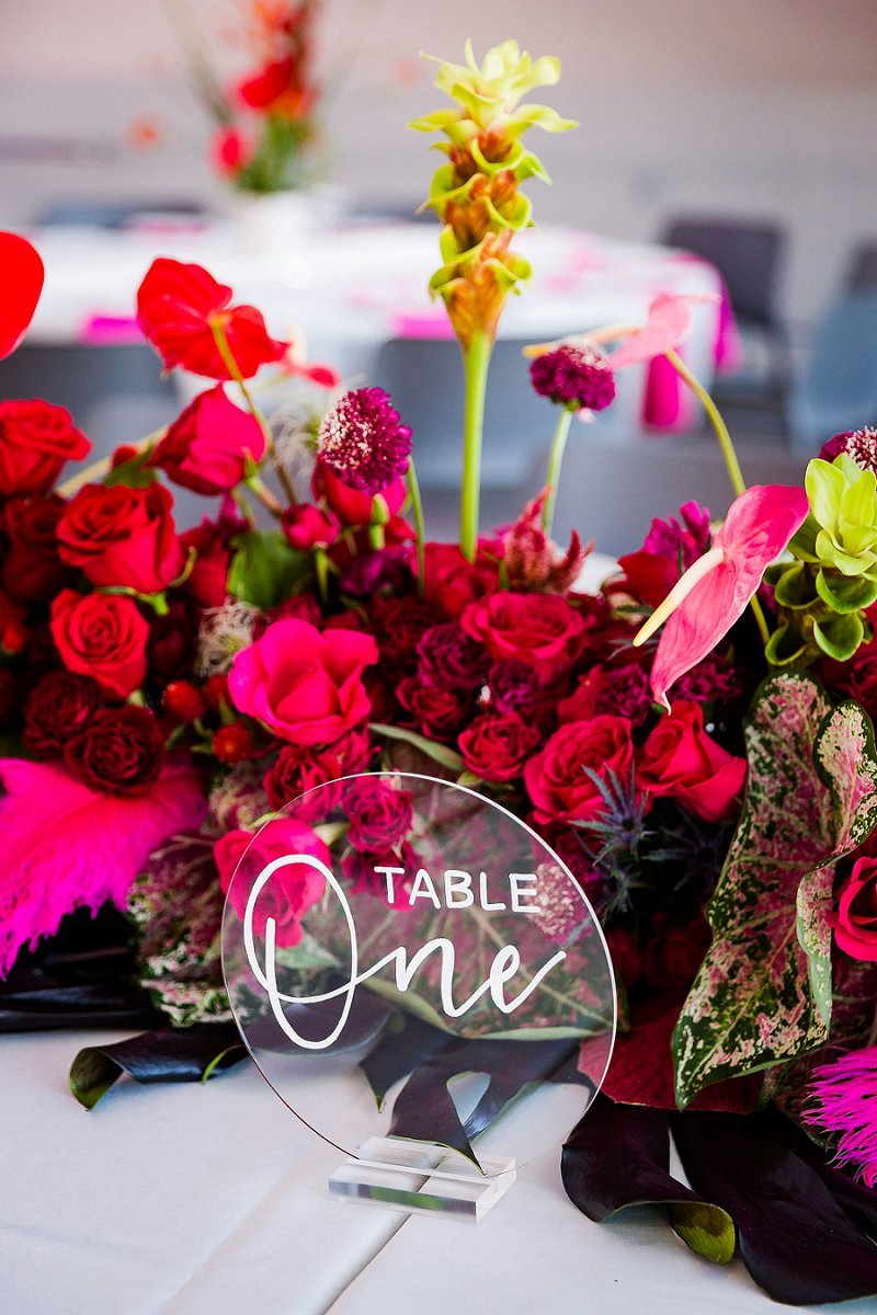 Round acrylic wedding table number with colorful ombre wedding floral centerpieces for unique modern wedding ideas