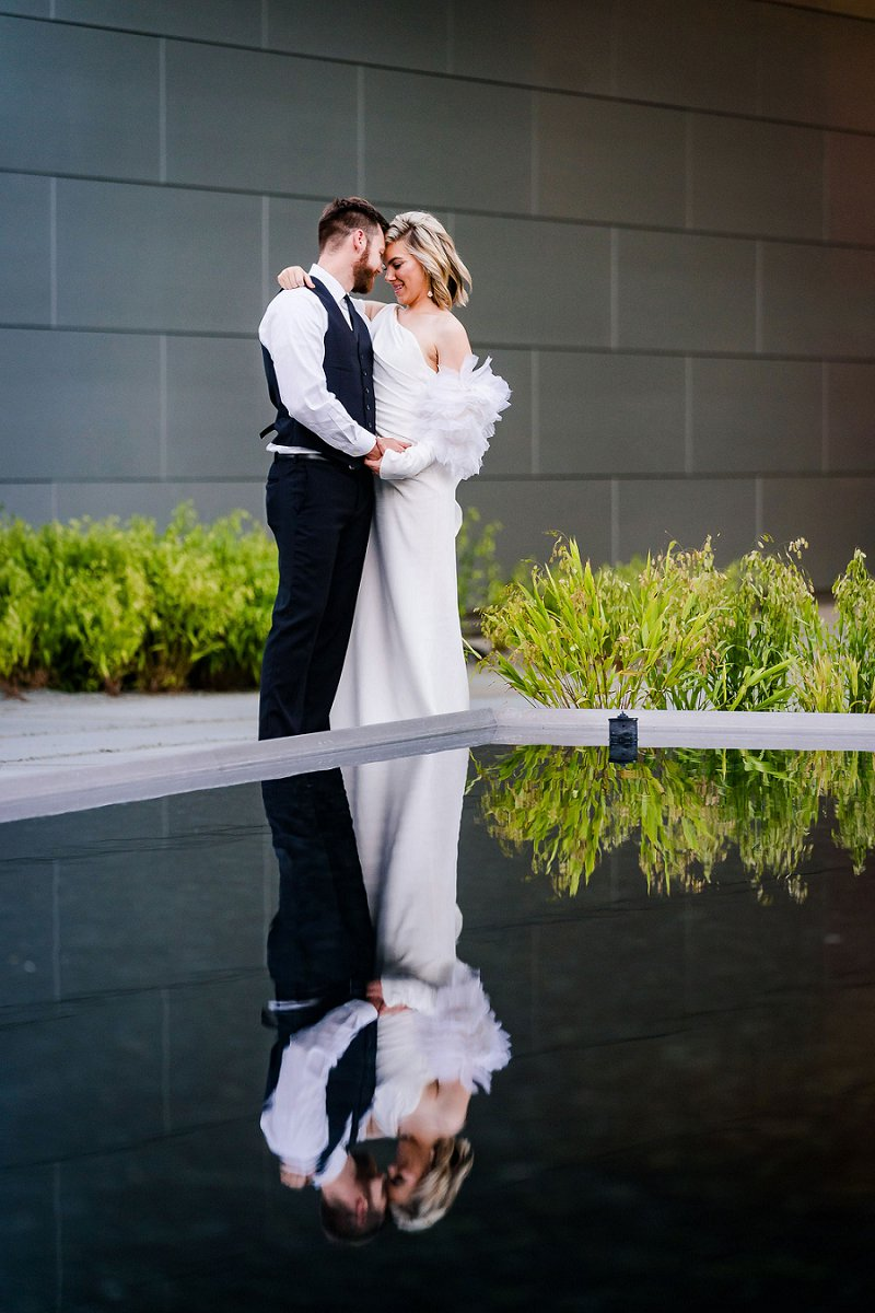 Beautiful bride and groom moment at their modern art museum wedding in Richmond Virginia