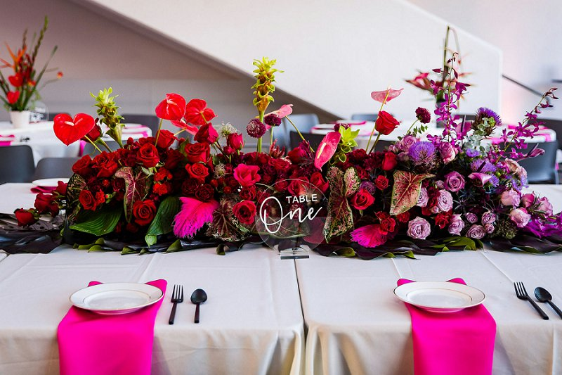 Ombre red and purple floral centerpiece with tropical and structural flowers for a modern art museum wedding