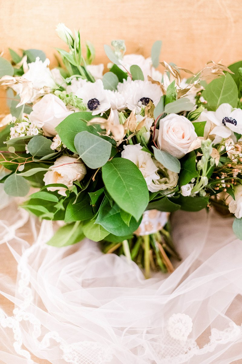 Winter wedding bouquet with gold painted ruscus and anemone flowers for classic florals