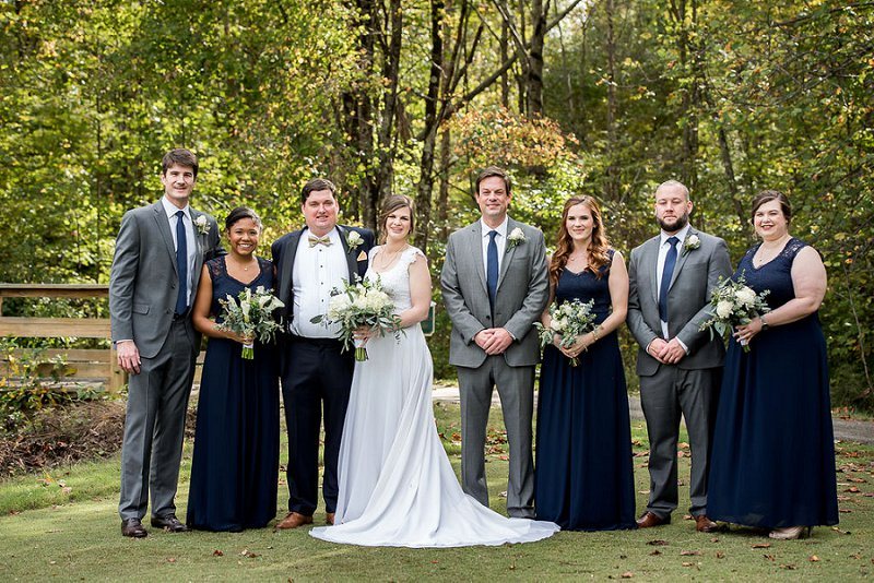 Bridesmaids in navy blue dresses from Amazon and groomsmen in gray suits for a classic DIY wedding at Independence Golf Club in Richmond Virginia