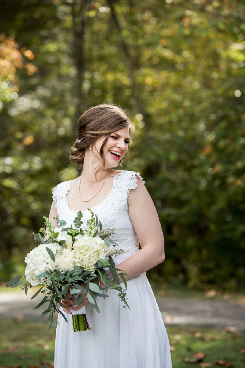 All white DIY handmade wedding bouquet with hydrangeas and eucalyptus
