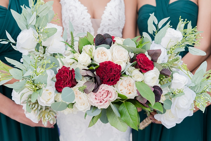 Lush wedding bouquets with red and pink roses and eucalyptus leaves for a Richmond Virginia wedding day