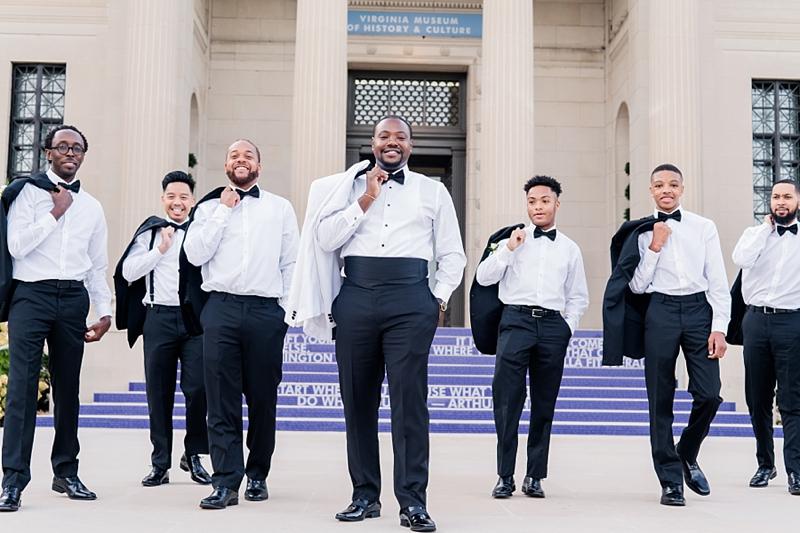 Classic black tie wedding attire with satin cummerbund and bow ties for timeless Richmond Virginia wedding