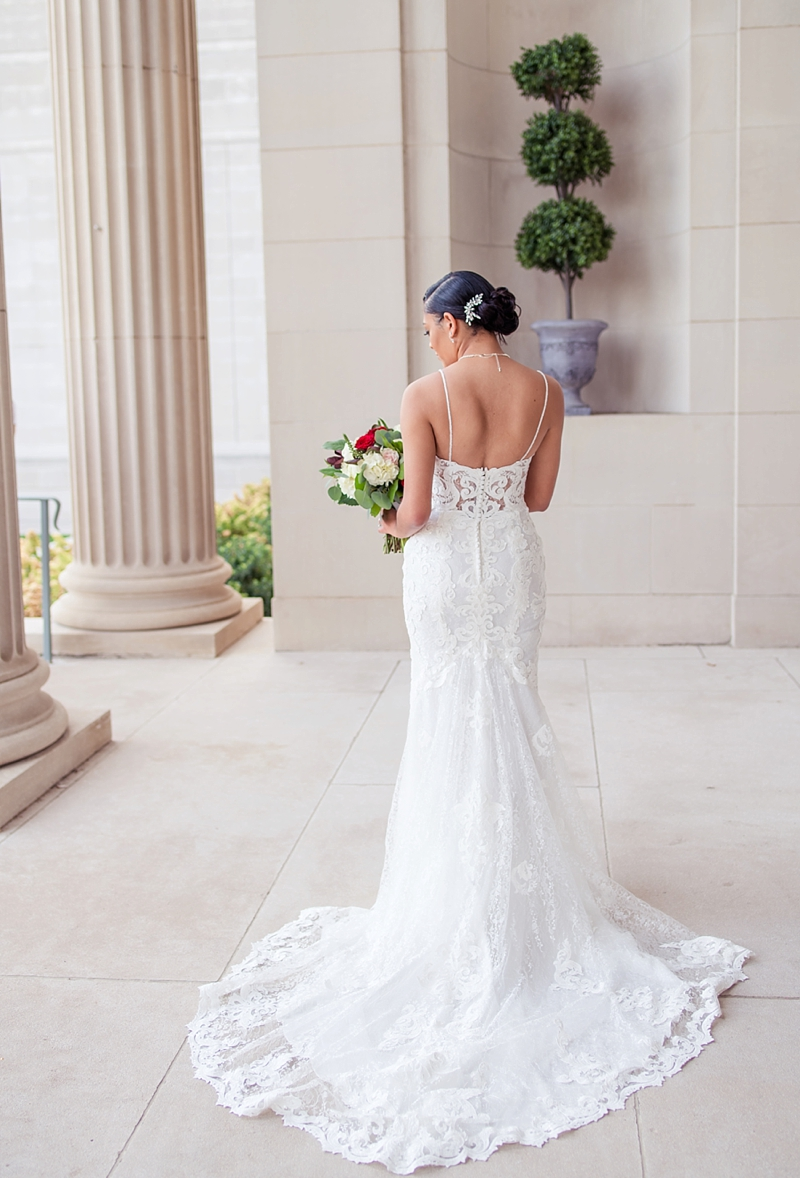 Romantic black bride with elegantly fitted wedding dress with beaded spaghetti straps and embroidered lace bodice ad short chapel train for ultimate timeless bridal look