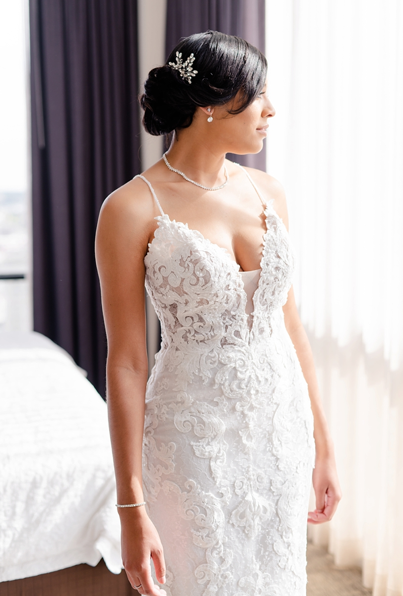 Classic black bride with elegant fitted wedding dress with beaded spaghetti straps and embroidered lace bodice for ultimate timeless bridal look
