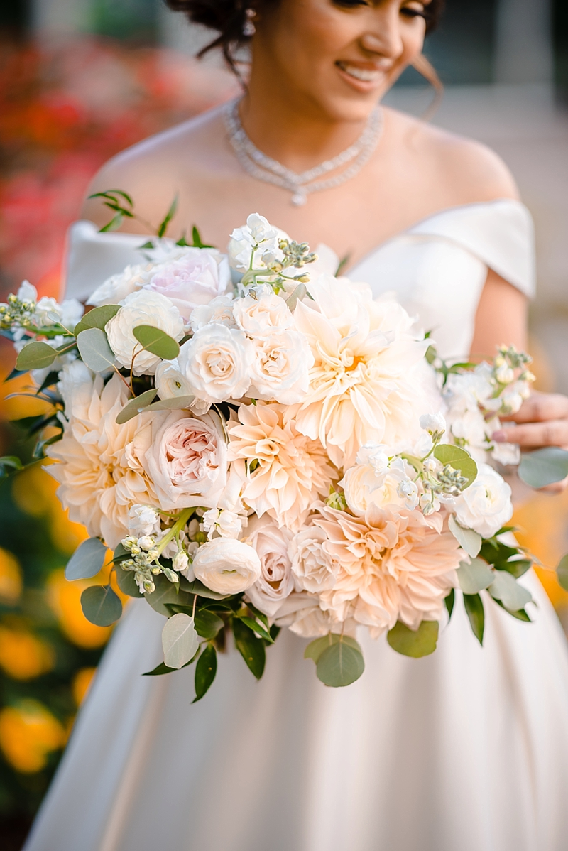 White pink and peach wedding bouquet with dahlias for timeless Indian bride in Richmond Virginia