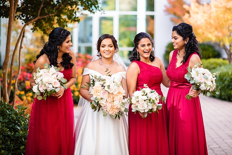 South Asian bridesmaids in red bridesmaid dresses for Richmond Virginia wedding day