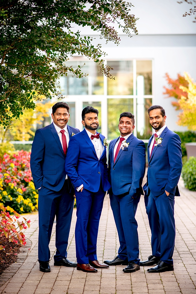 Groomsmen in modern blue suits and red bow ties and neckties for Indian wedding in Richmond Virginia