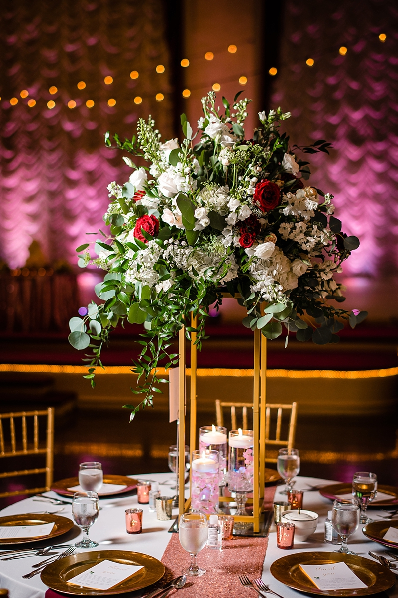Tall wedding floral centerpieces with white and red flowers standing on gold platform for classic glam wedding at The Renaissance in Richmond Virginia
