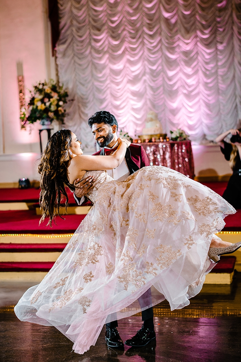 Beautiful bride and groom moment with a wardrobe change into a rose gold bridal gown and burgundy tuxedo at COVID affected Indian wedding