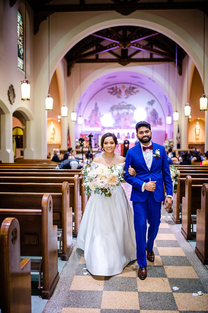 COVID19 affected wedding ceremony with social distanced seating and guests with face masks at St Josephs Villa in Richmond Virginia