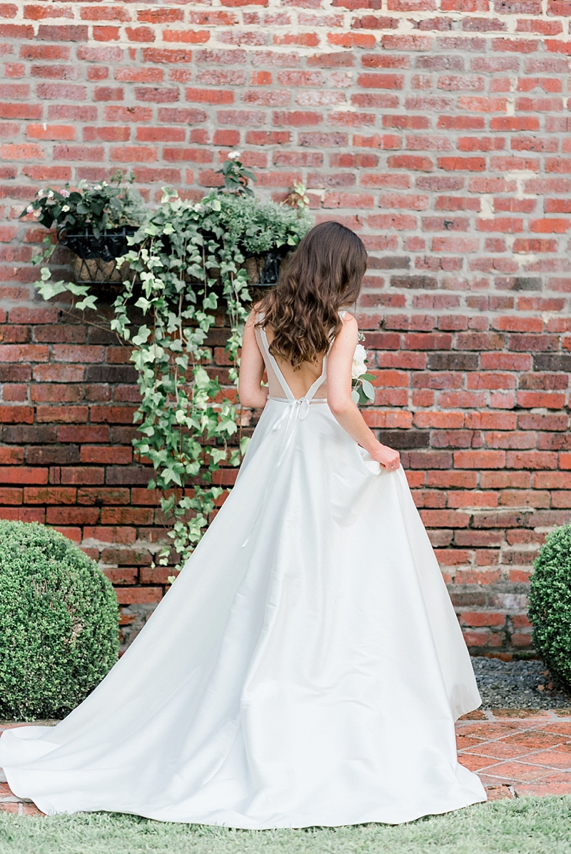 Gorgeous white wedding dress with dramatic statement deep V back and chapel train
