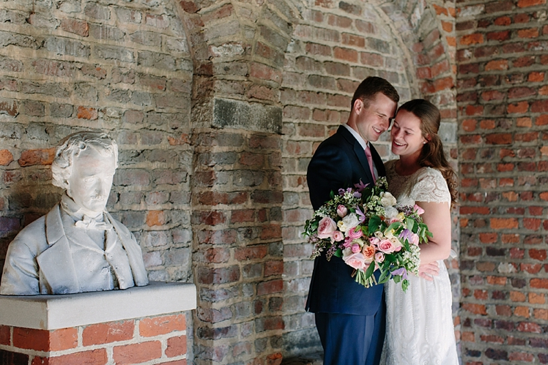Sweet spring wedding ceremony for engaged couple at the Edgar Allen Poe Museum in Richmond Virginia