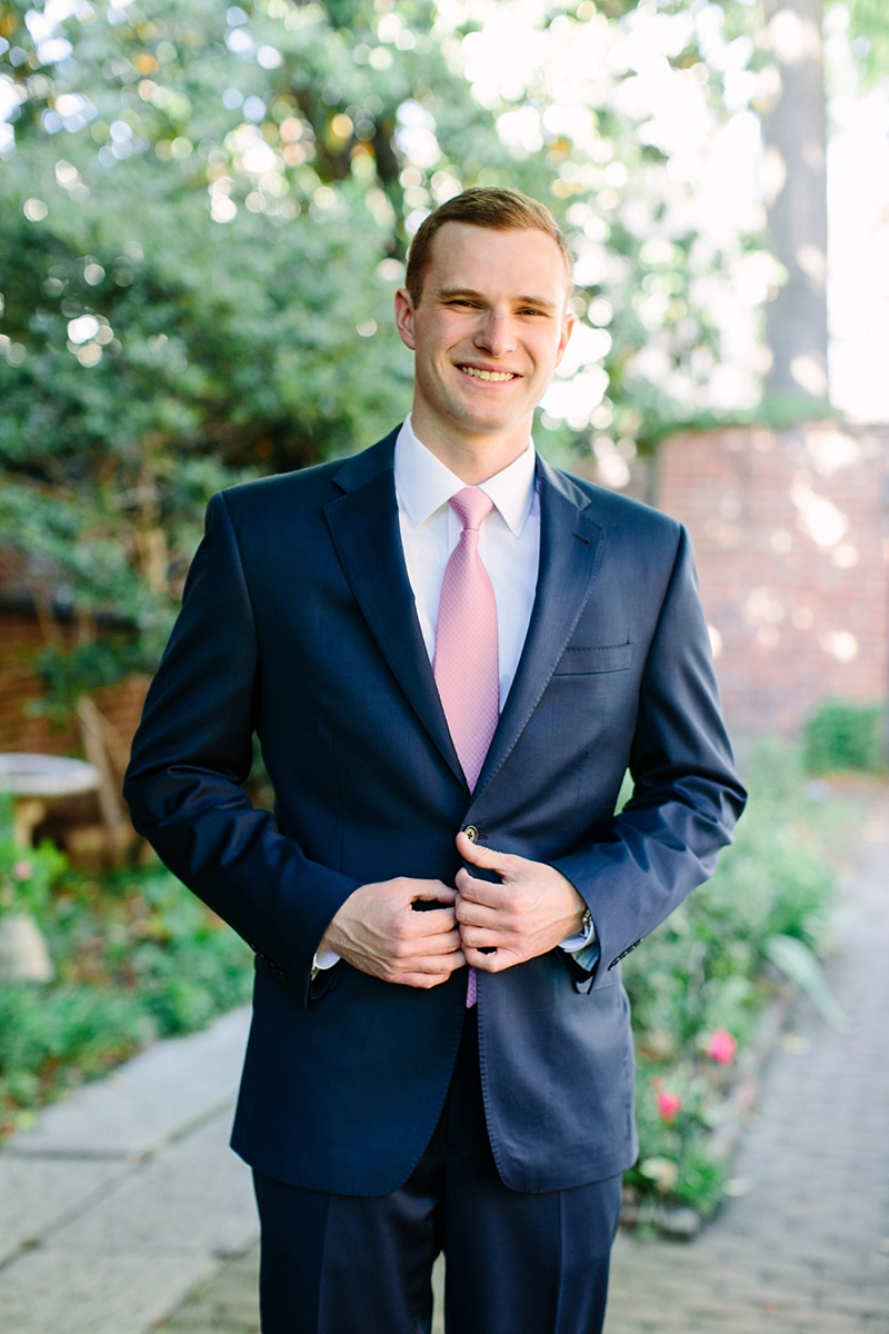 Navy blue suit with pink necktie look for a groom and garden wedding in Virginia