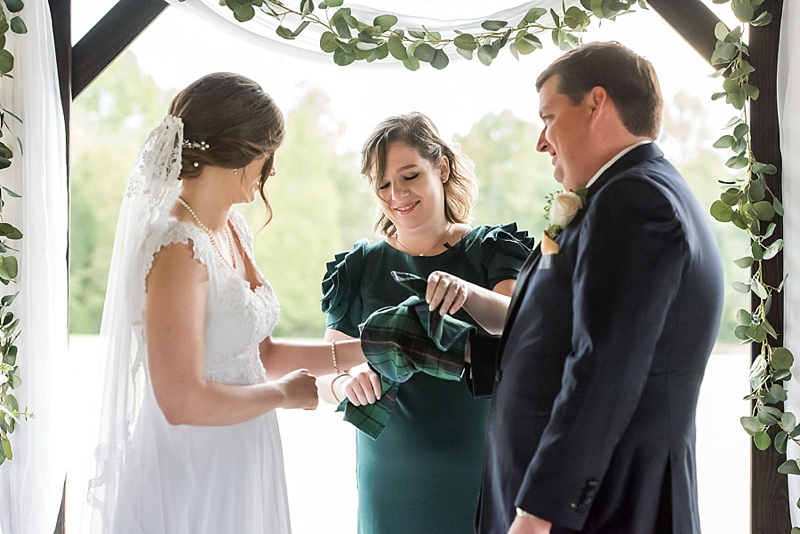Handfasting wedding ceremony using a Scottish tartan to incorporate family heritage in Virginia