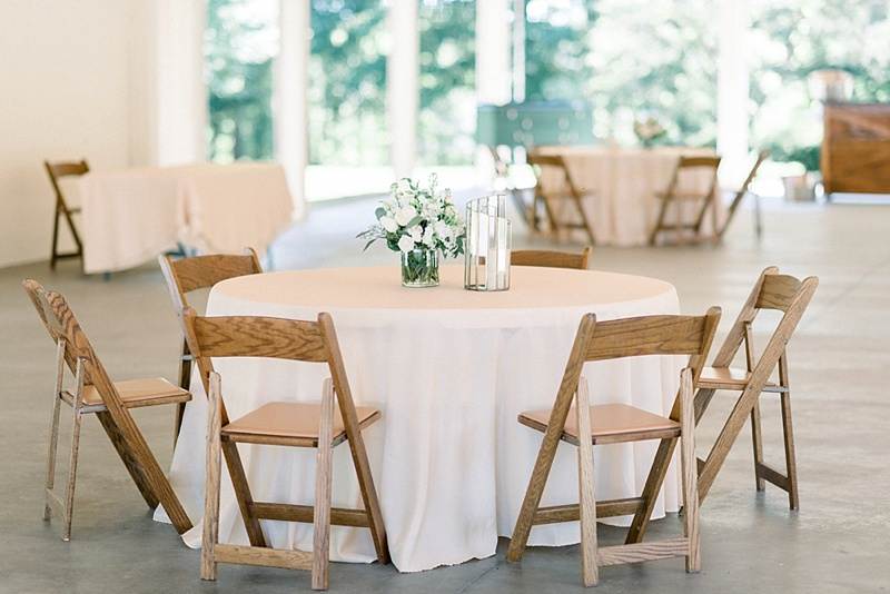 Socially distanced wedding reception tables with minimal table decor for beautiful COVID wedding