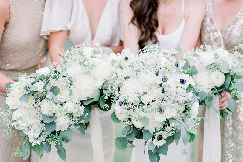 Gorgeous all-white wedding bouquets with anemones and roses for classic COVID wedding day