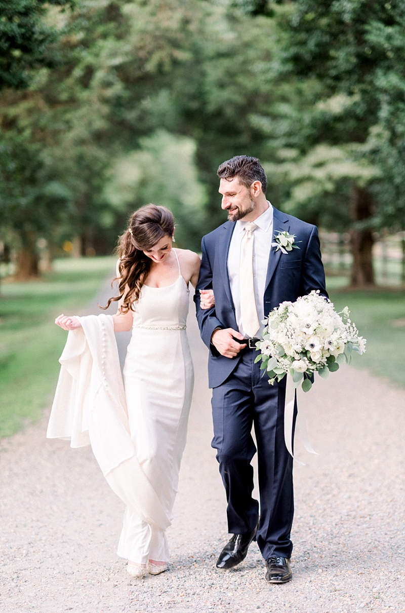 Bride wearing white spaghetti strap dress from BHLDN and ivory lace bridal heels for her classic COVID wedding in Virginia