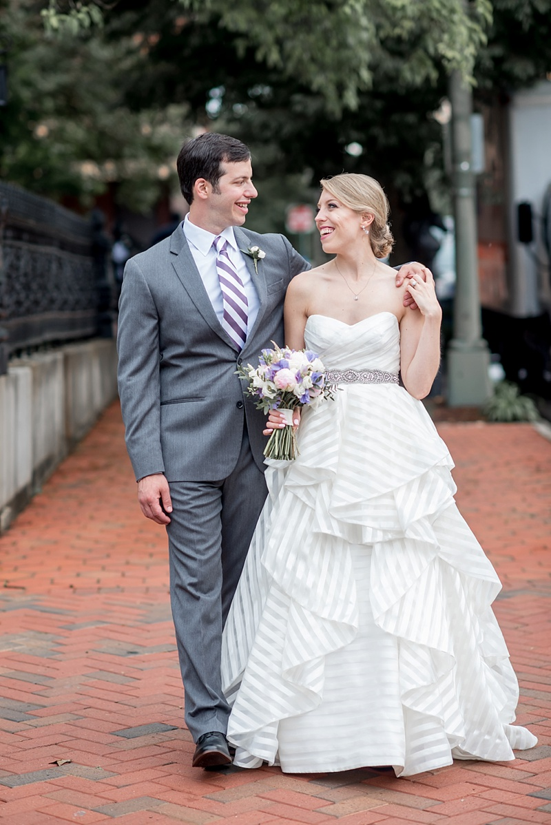 Gorgeous strapless striped wedding dress by Hayley Paige for preppy bride and purple white striped necktie for preppy groom