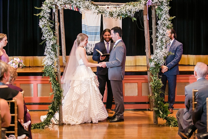 Lovely rustic wooden chuppah with babys breath for preppy Jewish wedding at Bolling Haxall House in Richmond Virginia