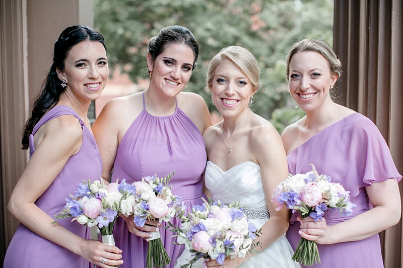 Lilac bridesmaid dresses with feminine pink and purple wedding bouquets